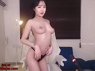 Korean babe oils her big boobs