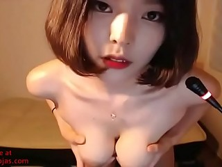 Busty Korean camgirl plays with her big boobs