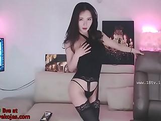 Korean beauty in black stockings and lingerie