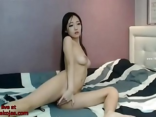 Big tits Korean camgirl in lingerie masturbates